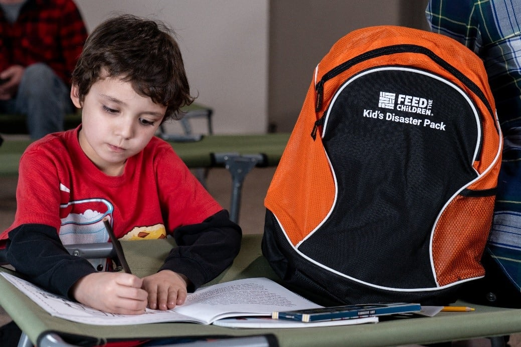 Boy with disaster backpack
