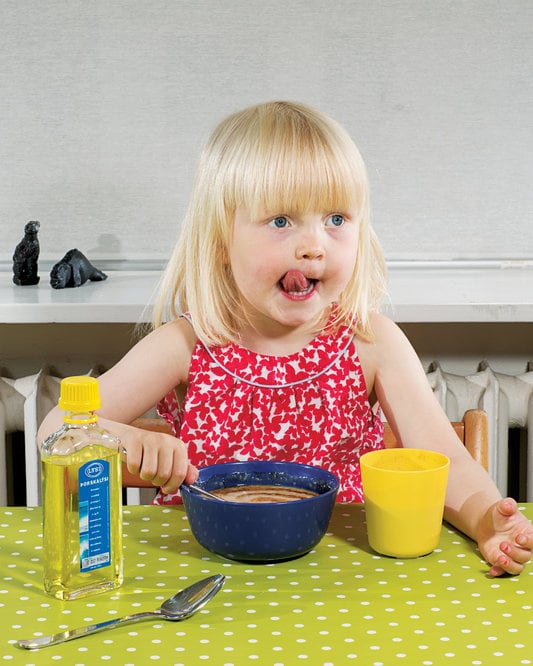 Blond haired child eating