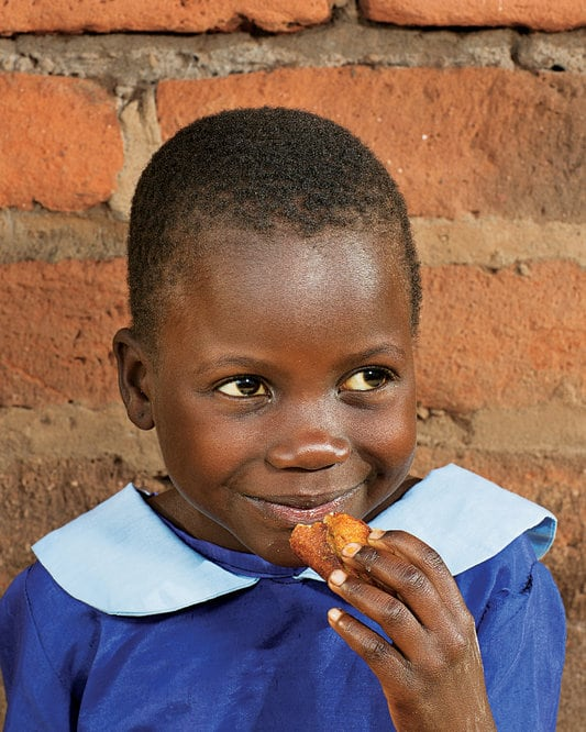 child eating in africa